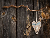 Wooden heart hanging on a branch Stock Photo