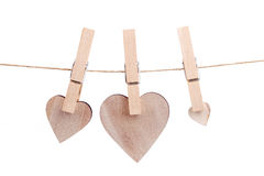 Wooden heart hanging on the clothesline Stock Photography