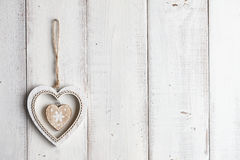 Wooden heart hanging on fence Stock Photography