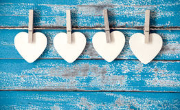 Wooden heart hanging on vintage blue wood background Royalty Free Stock Photos