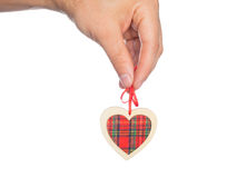 Wooden heart in his hand Stock Image