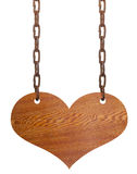 Wooden heart on the iron chains Stock Image