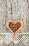 Wooden heart and lace fabric on the old wood Royalty Free Stock Images