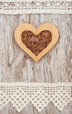 Wooden heart and lace fabric on the old wood Stock Images