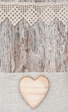 Wooden heart on the lace fabric and old wood Royalty Free Stock Photography