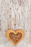 Wooden heart on the lace fabric and old wood Royalty Free Stock Photos