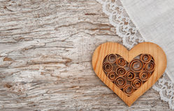 Wooden heart and linen fabric on the old wood Stock Photos