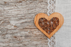 Wooden heart and linen fabric on the old wood Royalty Free Stock Image