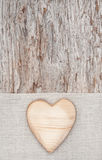 Wooden heart on the linen fabric and old wood Stock Photo