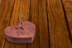 Wooden heart lock with gold key Stock Photo