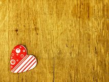Wooden heart on the oak table Stock Images