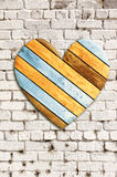 Wooden heart on old brick wall Stock Photography