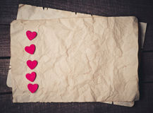 Wooden heart on old paper Stock Image