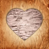 Wooden heart on the old paper background Royalty Free Stock Photos