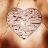 Wooden heart on the old paper background Royalty Free Stock Images