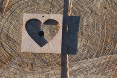 Wooden heart on an old surface Royalty Free Stock Photos