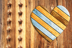 Wooden heart on old wood wall Royalty Free Stock Image