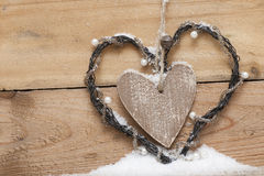 Wooden heart with perls in snow. In country style Stock Photo