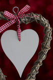 Wooden Heart with Ribbon on Red Stock Photos