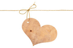 Wooden heart on a rope with a bow Royalty Free Stock Image