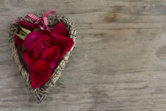 Wooden Heart with Rose and Petals Royalty Free Stock Image