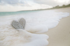 Wooden heart in sea waves, live action Stock Image