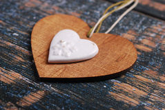 Wooden heart on shabby old background Stock Photography