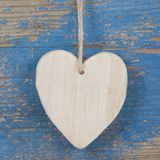 Wooden heart shape on blue wooden surface for valentine, birthda Royalty Free Stock Photo