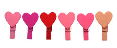 Wooden heart shape clips isolated on white.  Royalty Free Stock Photo