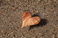 Wooden heart shape in the nature for greeting card. Royalty Free Stock Photo