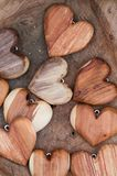 Wooden heart shapes on brown background Royalty Free Stock Photography