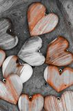 Wooden heart shapes on brown background Stock Images