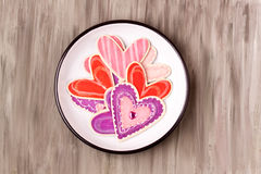 Wooden heart shapes on a enamel plate Stock Images