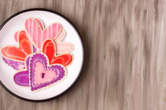 Wooden heart shapes on a enamel plate Royalty Free Stock Photography