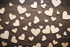 Wooden heart shapes on the table Royalty Free Stock Photography