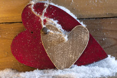 Wooden heart in snow Royalty Free Stock Photo