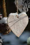 Wooden heart in snow Royalty Free Stock Image