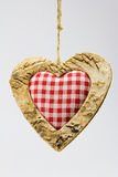 Wooden heart and squared textile Stock Photos