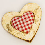 Wooden heart, squared textile in the middle Stock Photography