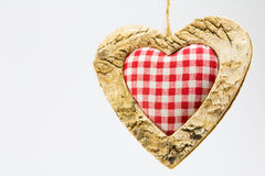 Wooden heart, squared textile in the middle Stock Image
