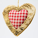 Wooden heart, squared textile in the middle Royalty Free Stock Photos