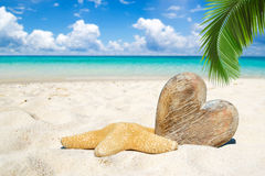 Wooden heart and starfish on the beach Stock Photography
