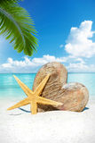 Wooden heart and starfish on the beach Royalty Free Stock Photo