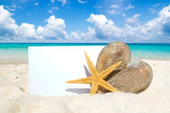 Wooden heart, starfish and postcard Royalty Free Stock Photo