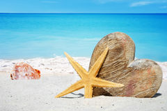 Wooden heart, starfish and seashells Royalty Free Stock Images