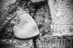 Wooden heart on stoned wall in outdoor - Love concept. Closeup of wooden heart on stoned wall in outdoor - Love concept Royalty Free Stock Photos
