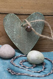 Wooden heart and sweet eggs in pastel Royalty Free Stock Image