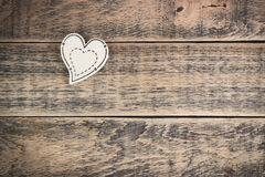 Wooden heart on  texture. Wooden heart on wooden texture with empty space Royalty Free Stock Photos