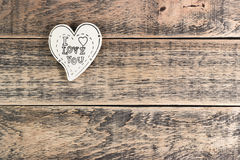 Wooden heart on  texture. Wooden heart on wooden texture with empty space Royalty Free Stock Photo