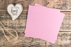 Wooden heart on  texture. Wooden heart on wooden texture and sticker under the text Royalty Free Stock Photos